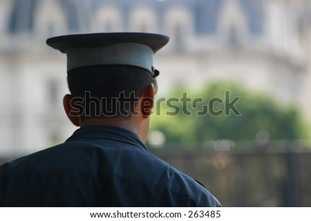 Police officer from behind - stock photo