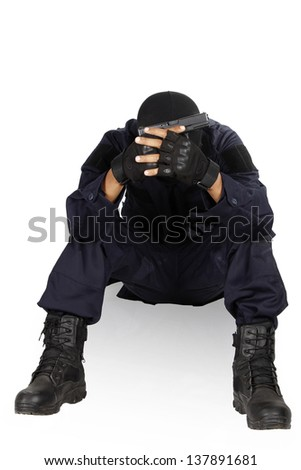 Police officer holding with handgun semi-automatic - stock photo