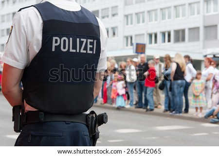 Police officer in front of a crowd
