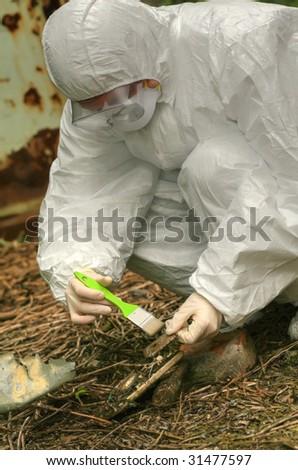 police officer investigating a crime scene - stock photo