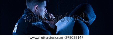 Police officer is reporting that he arrested a bandit - stock photo