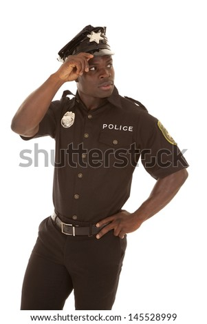 Police officer looking back over his shoulder. - stock photo