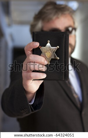 Police officer show identification badge - stock photo