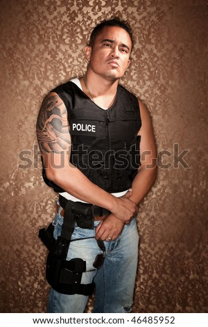 Police Officer with Bulletproof Vest on Gold Background - stock photo