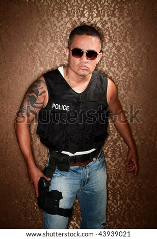 Police Officer with Gun Strapped to His Thigh - stock photo