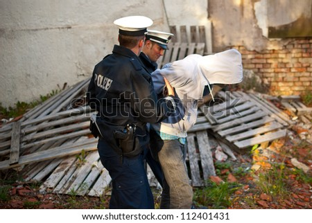 Police officers arresting a criminal - stock photo