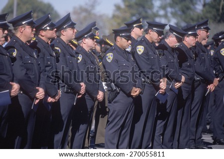Police officers at funeral ceremony, Pleasanton, California - stock photo