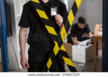 Police officers must show their identification tags  - stock photo