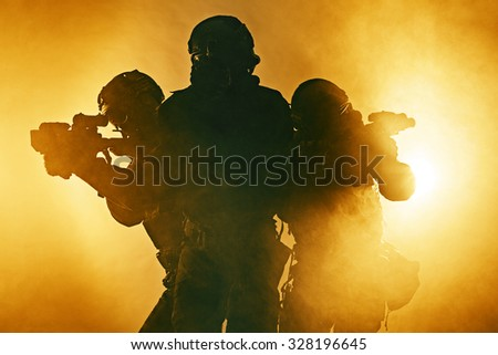 Police officers SWAT in black uniform in the smoke studio shot - stock photo