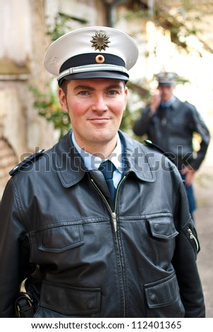 Police officers with a friendly face - stock photo