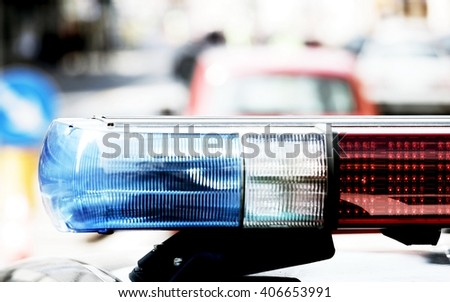 police patrol car with sirens during a traffic control in the metropolis
