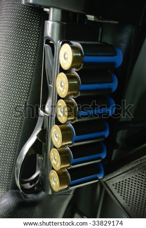 Police shotgun in cruiser. Vertical format. - stock photo