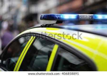 Police siren flashing blue lights at accident or crime scene - stock photo