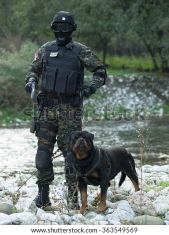 Police special forces,filtered and under exposed photo.National flag on his arms and chest - stock photo