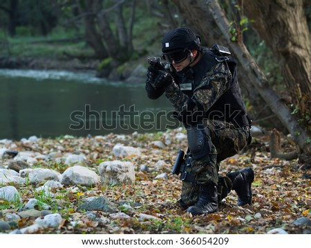 Police special forces, under exposed photo.National flag on his arms - stock photo