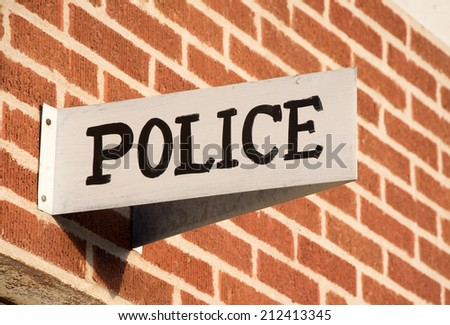 Police station sign in a small rural town - stock photo