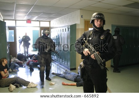 Police SWAT team members practicing an anti-terrorism drill. Editorial use only. - stock photo