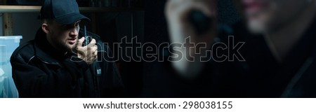 Policeman and his partner are calling for a back up  - stock photo