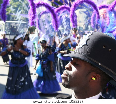 Policeman at the Notting Hill Carnival, London - stock photo