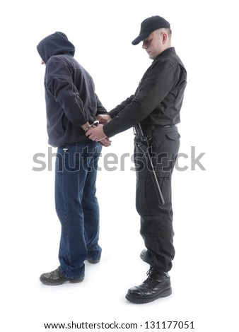 Policeman handcuffing hooded man, shot on white - stock photo