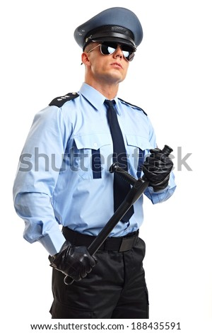 Policeman in sunglasses holds at hand police baton  - stock photo