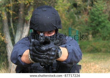 policeman pointing weapons at the camera, detail - stock photo