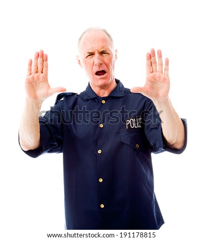 Policeman stopping with hand gesture - stock photo