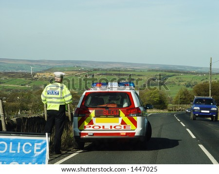 Policeman with car, stopping traffic in one direction - stock photo