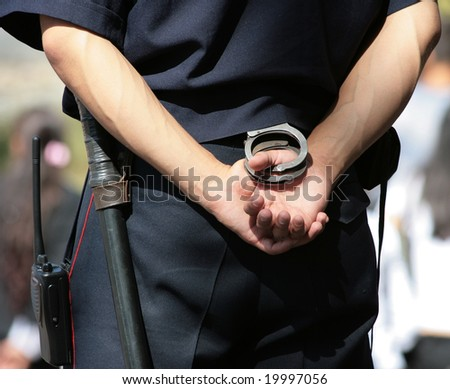 Policeman with handcuffs - stock photo