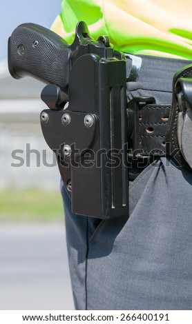 Policeman with the gun - stock photo