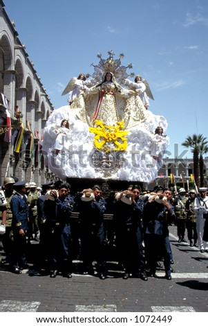 Policemen carry a statue of Our Lady through the streets of Arequipa, a town in Southern Peru - stock photo