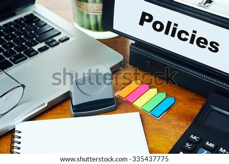 Policies- Ring Binder on Office Desktop with Office Supplies. Business Concept on Toned and Blurred Background - stock photo