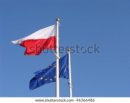 Polish and European Union flags. - stock photo