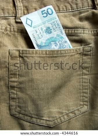 Polish bank note in a back trouser pocket - stock photo