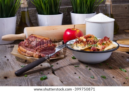 Polish fried dumplings with meat, onion and bacon. - stock photo