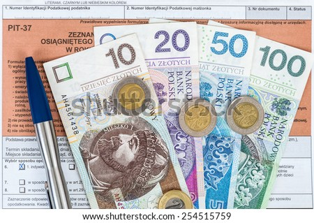 Polish individual tax form PIT-37 with money and pen - stock photo