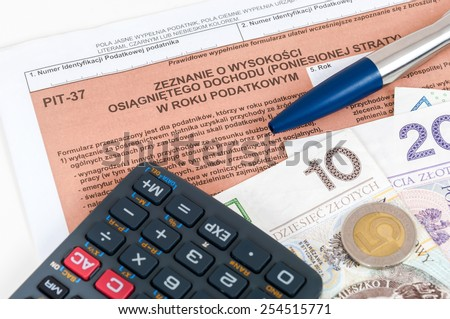 Polish individual tax form PIT-37 with money, pen and calculator