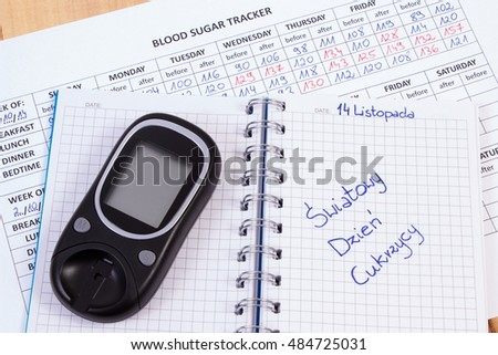 Polish inscription world diabetes day written in notebook, medical forms with results of measurement of sugar and glucose meter, symbol of diabetic and fight against diabetes
