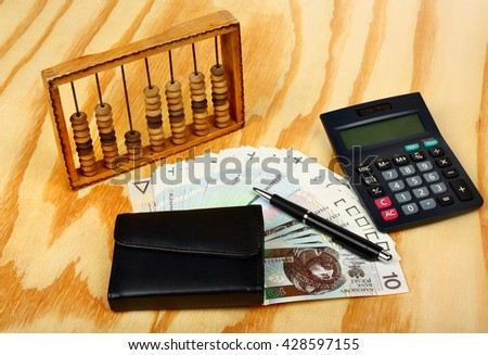 Polish money, calculator, pen, wallet and abacus