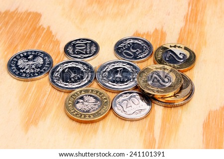 Polish money coins on the wooden table - stock photo