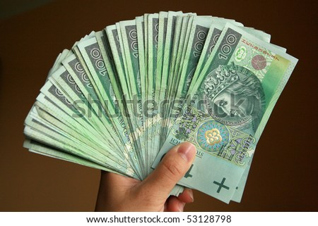 Polish Money in hand. Banknotes from Poland. - stock photo