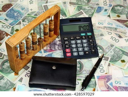 Polish money, pen, wallet, abacus on the banknote background - stock photo