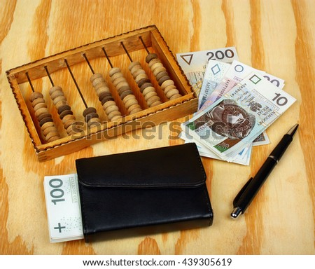 Polish money, pen, wallet and abacus - stock photo