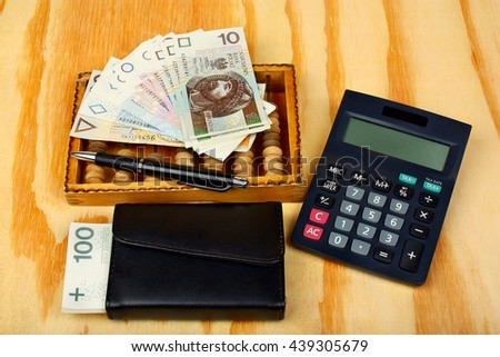 Polish money, pen, wallet, calculator and abacus - stock photo