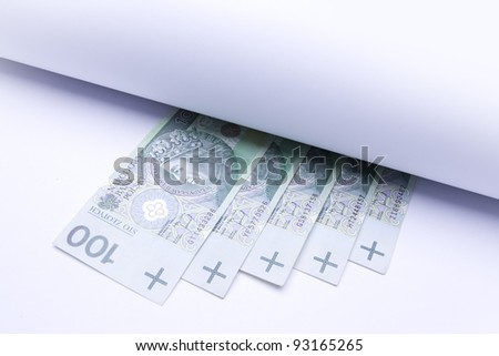 polish money: zloty, banknotes under roll of paper for insert text or design - stock photo