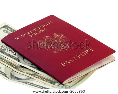 Polish passport and American dollars - stock photo