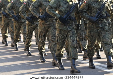 Polish soldiers marching - stock photo
