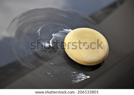 polish wax on the car  - stock photo