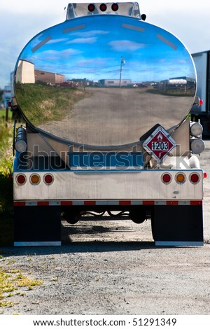 Polished chrome tank of a gasoline tanker truck - stock photo