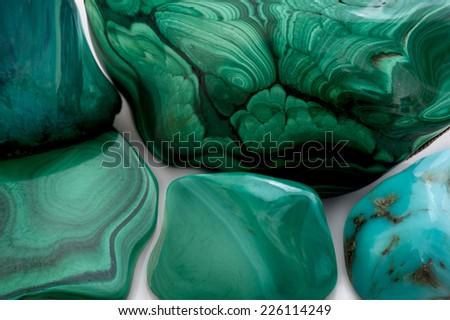 Polished malachite isolated on a white background - stock photo